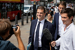 © Licensed to London News Pictures. 24/07/2018. London, UK. Olly Robbins (centre), Theresa May's Europe Adviser, on Whitehall as he heads to Portcullis House to appear in front of a select committee. Photo credit: Rob Pinney/LNP