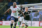 Bolton Wanderers forward Shola Ameobi  and Brentford defender Jake Bidwell  during the Sky Bet Championship match between Bolton Wanderers and Brentford at the Macron Stadium, Bolton, England on 30 November 2015. Photo by Simon Davies.
