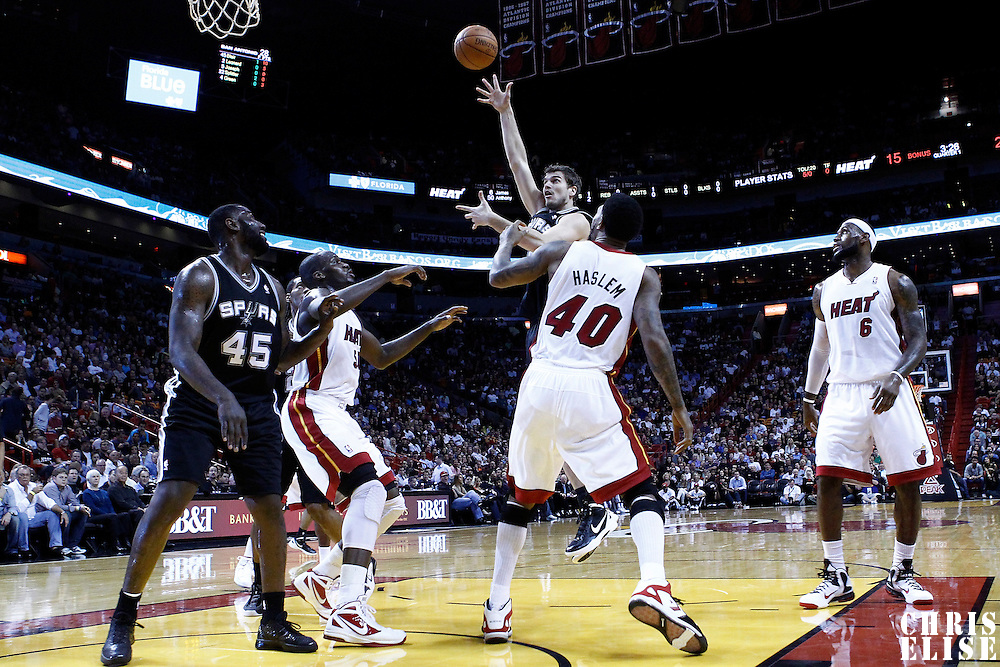 17 January 2012: San Antonio Spurs forward Tiago Splitter (22) goes for the sky hook over Miami Heat power forward Udonis Haslem (40) during the Miami Heat 120-98 victory over the San Antonio Spurs at the AmericanAirlines Arena, Miami, Florida, USA.