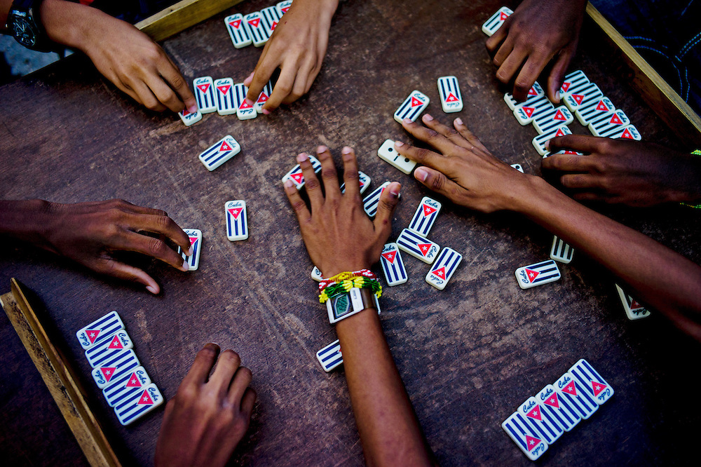 Neighbors play domino in a street in Centro Havana. Cuba. October 27, 2012. Photo/Tomas Munita