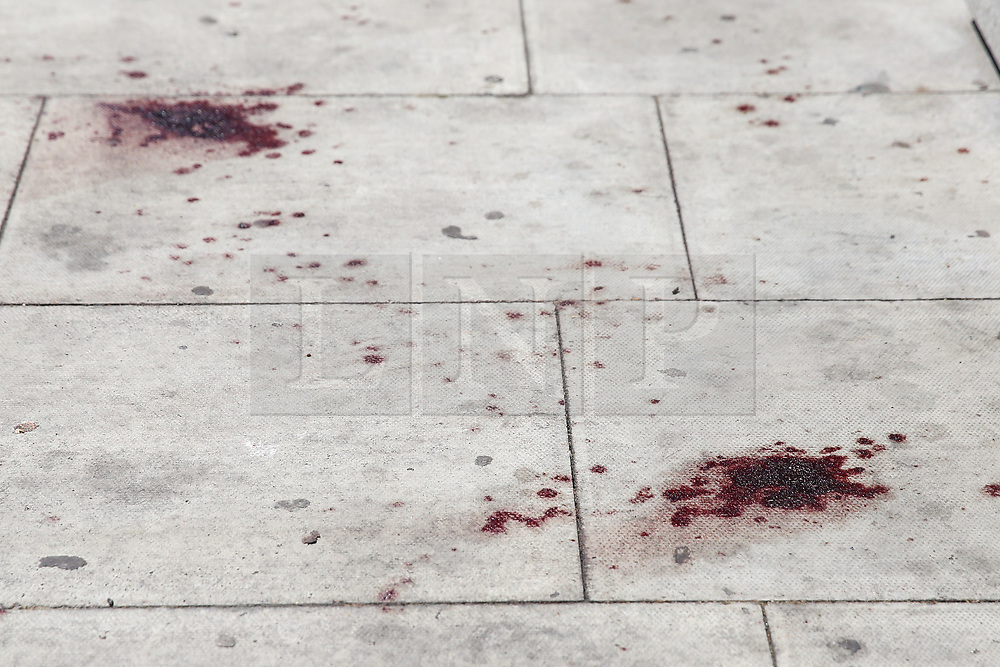 © Licensed to London News Pictures. 28/05/2019. London, UK. Blood is seen on Romford Road (opposite Warwick Road), Forest Gate in East London where a man in his 30s died in the early hours of this morning following a fight on Warwick Road.<br /> Police officers were called after the victim was found suffering from stab injuries and he died later in the hospital. Photo credit: Dinendra Haria/LNP CAPTION UPDATED WITH CORRECT DATE