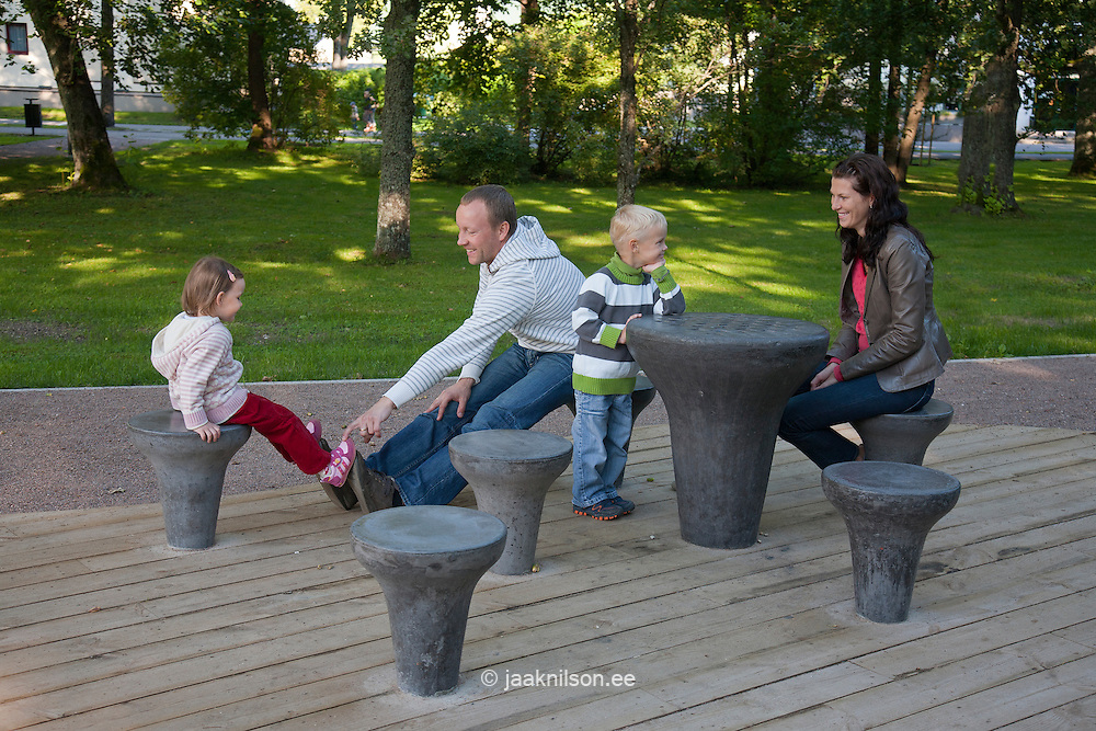 Young Family Sitting in Park, Chess Grounds in Pärnu Rannapark, Estonia, Europe