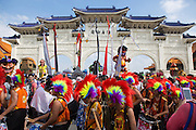 Elementary school students in rainbow wigs move in front of the gate at Chiang Kai Shek Memorial Hall. They were participants in the Dream Parade, an annual arts carnival and street parade that takes place in Taipei. The event is the brainchild of real estate developer Gordon Tsai who founded the Dream Community after being inspired by simialr events in other parts of the world.