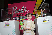 "Sydney ""Mayhem"" Keiser, founder of Fashion by Mayhem, poses with her one-of-a-kind Barbie at the Variety Power of Women event, Friday, April 24, 2015, in  New York, where she was honored as a ""Shero.""  Sydney, along with Ava DuVernay, Emmy Rossum, Eva Chen, Kristin Chenoweth and Trisha Yearwood, are the first ever Barbie Sheroes, which celebrates women who are inspiring girls.  (Photo by Diane Bondareff/Invision for Barbie/AP Images)"