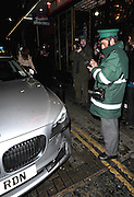 17.FEBRUARY.2011. LONDON<br /> <br /> KATIE PRICE ATTENDED THE WEST END SHOW BLOOD BROTHERS AT THE PHOENIX THEATRE IN CENTRAL LONDON. KATIE LEFT THE THEATRE AND WAS GREETED BY A CROWD OF FANS AS SHE GOT INTO HER CAR.<br /> KATIE'S DRIVER PROCEEDED TO REV HIS ENGINE TO SCARE PEOPLE OUT OF THE WAY, UNFORTUNATLY THE DRIVER LOST CONTROL OF THE VEHICLE AND HIT A BULLARD. SADLY FOR THE DRIVER A BYSTANDER WAS CLIPPED BY THE CAR AND WENT TO HOSPITAL AND TO TOP IT ALL OFF, THE DRIVER WAS ISSUED WITH A PARKING TICKET FOR HIS TROUBLES.<br /> <br /> BYLINE: EDBIMAGEARCHIVE.COM<br /> <br /> *THIS IMAGE IS STRICTLY FOR UK NEWSPAPERS AND MAGAZINES ONLY*<br /> *FOR WORLD WIDE SALES AND WEB USE PLEASE CONTACT EDBIMAGEARCHIVE - 0208 954 5968*