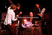 Medeski, Martin and Wood with Oliver Wood (seated)   performing at Music For Youth's tribute to Bob Dylan at Avery Fisher Hall in Lincoln Center on November 9, 2006