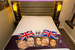 Various items of royal memorabilia left behind by guests are laid out on a bed. London, July 24 2019.