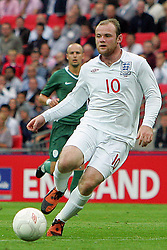 Wayne Rooney in action during the international friendly match between England and Slovenia at Wembley Stadium, London on the 5th September 2009