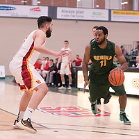 4th year forward Brian Ofori (11) of the Regina Cougars in action during the home game on January  28 at Centre for Kinesiology, Health and Sport. Credit: Arthur Ward/Arthur Images
