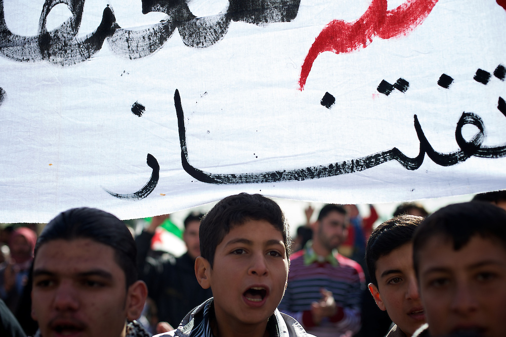 January 20, 2012 - Idleb, Syria: Children protestors shout anti-regime words during a demonstrations anti-regime in central Taftanaz, Idleb.