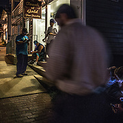 OCCOQUAN, VA - AUG4: People flock to the streets of  Occoquan, Virginia, to play Pokemon Go, August 4th, 2016. This sleepy Virginia town has become a hotspot for Pokemon Go. Throughout the night, kids and young adults play the game on the streets, leaving beer bottles and litter behind. A few residents have complained to city hall and now the city is hiring extra police officers to handle the new masses. (Photo by Evelyn Hockstein/For The Washington Post)