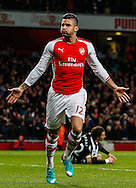 Olivier Giroud of Arsenal celebrates scoring the opening goal against Newcastle United during the Barclays Premier League match at the Emirates Stadium, London<br /> Picture by David Horn/Focus Images Ltd +44 7545 970036<br /> 13/12/2014