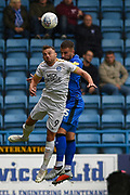Peterborough United forward Matt Godden (9) and Gillingham FC defender Max Ehmer (5) during the EFL Sky Bet League 1 match between Gillingham and Peterborough United at the MEMS Priestfield Stadium, Gillingham, England on 22 September 2018. Picture by Martin Cole