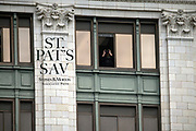 A U.S. Secret Service agent peers out of a window with high-powered binoculars while Vice President Mike Pence walks in the St. Patrick's Day parade, Saturday, March 17, 2018, during the St. Patrick's Day parade in Savannah, Ga. Irish immigrants to Savannah and their descendants have been celebrating St. Patrick's Day with a parade since 1824. (AP Photo/Stephen B. Morton)
