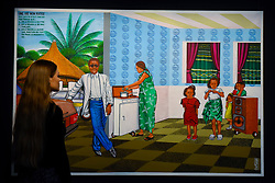 """© Licensed to London News Pictures. 12/05/2017. London, UK.   A staff member views """"Une vie non ratée (A Successful Life)"""", 1995, by Chéri Samba (Congo) (Est. GBP 20-30k) at the preview for the first sale dedicated to Modern and Contemporary African Art at Sotheby's New Bond Street.  The sale features over 115 artworks by over 60 different artists from 14 countries across the continent. Photo credit : Stephen Chung/LNP"""