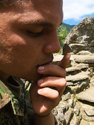 "A Colombian soldier shows off how the ""98"" butterfly likes to tickle his nose - Ciudad Perdida - Colombia"