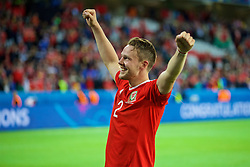 LILLE, FRANCE - Friday, July 1, 2016: Wales' Chris Gunter celebrates after a 3-1 victory over Belgium and reaching the Semi-Final during the UEFA Euro 2016 Championship Quarter-Final match at the Stade Pierre Mauroy. (Pic by David Rawcliffe/Propaganda)