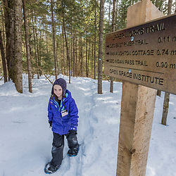 A girl snowshoeing on the Upper Works Trail, Tahawus Tract, Newcomb, New York. Adirondack Mountains.