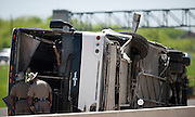 Two DPS officers inspect the overturned Cardinal Coach Line charter bus on Hwy. 161 near N. Belt Line Rd.  in Irving on Thursday, April 11, 2013. The accident resulted in two deaths and 41 hospitalized. (Cooper Neill/The Dallas Morning News)