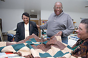 Zakes Mda env. Portrait for Ohio Today with quilts and at Kilvert Community Center with Irene Flowers(dark jacket) and Barbara Sue Male Parsons(gray hair)