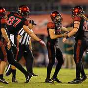 22 September 2018: San Diego State Aztecs place kicker John Baron II (29) is congratulated by tight end Parker Houston (82) after hitting a 34 yard field goal to give the Aztecs a 3-0 lead in the first quarter. The San Diego State Aztecs beat the Eastern Michigan Eagles 23-20 in over time at SDCCU Stadium in San Diego, California.