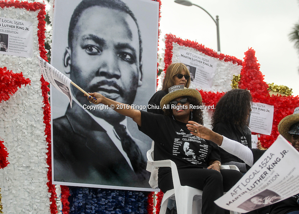 Participants wave to parade goers as the Martin Luther King Jr. parade makes it's way down Martin Luther King Blvd. in Los Angeles on Monday Jan. 18, 2016. The 31st annual Kingdom Day Parade honoring Martin Luther King Jr. was themed &quot;Our Work Is Not Yet Done&quot;(Photo by Ringo Chiu/PHOTOFORMULA.com)<br /> <br /> Usage Notes: This content is intended for editorial use only. For other uses, additional clearances may be required.