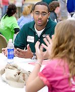 O.U. student Eric Haynesworth talks with high school students during the Russ College of Engineering and Technology research fair/engineering day in the Baker Center ballroom on Thursday, 5/3/07.
