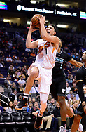 Jan 30, 2017; Phoenix, AZ, USA; Phoenix Suns guard Devin Booker (1) drives to the basket in the second half of the NBA against the Memphis Grizzlies at Talking Stick Resort Arena. The Memphis Grizzlies won 115-96. Mandatory Credit: Jennifer Stewart-USA TODAY Sports