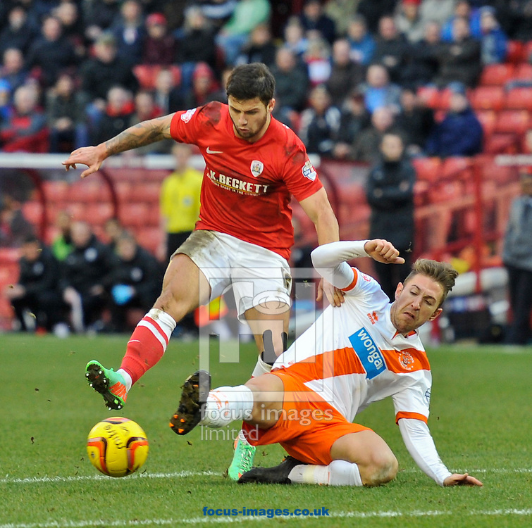 Picture by Richard Land/Focus Images Ltd +44 7713 507003<br /> 18/01/2014<br /> <br /> Dale Jennings of Barnsley and Angel Martinez of Blackpool during the Sky Bet Championship match at Oakwell, Barnsley.