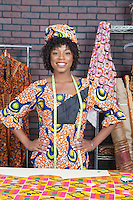 Portrait of pretty African American female fashion designer standing with hands on hips