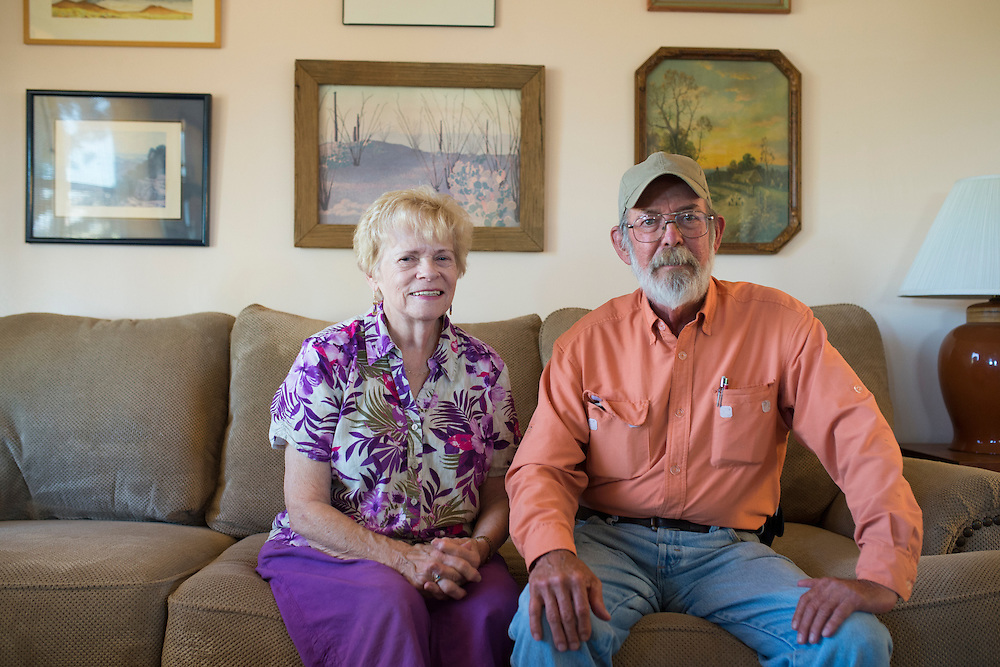 Suzanne Bailey and Tom Short pose for a photo at their home in Alpine, Texas where Pumpco has cleared acres of land just feet from their home for a future natural gas pipeline on June 17, 2015. (Cooper Neill for The Texas Tribune)