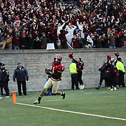 Andrew Fischer, Harvard, catches a 35-yard touchdown pass from Conner Hempel for the winning touchdown with 55 seconds to play as Harvard beat Yale 31-24 to capture the Ivy League title outright during the Harvard Vs Yale, College Football, Ivy League deciding game, Harvard Stadium, Boston, Massachusetts, USA. 22nd November 2014. Photo Tim Clayton