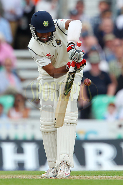 Cheteshwar Pujara of India mis times a delivery from Stuart Broad of England during day one of the fifth Investec Test Match between England and India held at The Kia Oval cricket ground in London, England on the 15th August 2014<br /> <br /> Photo by Ron Gaunt / SPORTZPICS/ BCCI