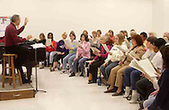 Neal Gittleman leads the women of the Dayton Philharmonic Chorus as they rehearse for their upcoming performance of Mahler's Third Symphony, Tuesday, January 2, 2007.