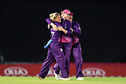 Lucy Higham, Kirstie Gordon and Abigail Freeborn of Loughborough Lightning celebrate the wicket of Danielle Wyatt during the Women's Cricket Super League match between Southern Vipers and Loughborough Lightning at the Ageas Bowl, Southampton, United Kingdom on 28 August 2019.