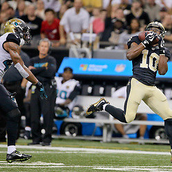 Dec 27, 2015; New Orleans, LA, USA; New Orleans Saints wide receiver Brandin Cooks (10) catches a touchdown against the Jacksonville Jaguars during the second quarter of a game at the Mercedes-Benz Superdome. Mandatory Credit: Derick E. Hingle-USA TODAY Sports