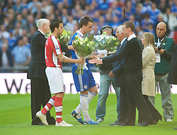 LONDON, ENGLAND - Saturday, April 18, 2009: Arsenal's Cesc Fabregas and Chelsea's' captain John Terry present flowers to Trevor Hicks of the Hillsborough Family Support Group before the FA Cup Semi-Final match at Wembley. (Photo by: David Rawcliffe/Propaganda)