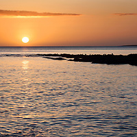 Sunrise over the Sea from Castle Sands at St Andrews Fife Scotland