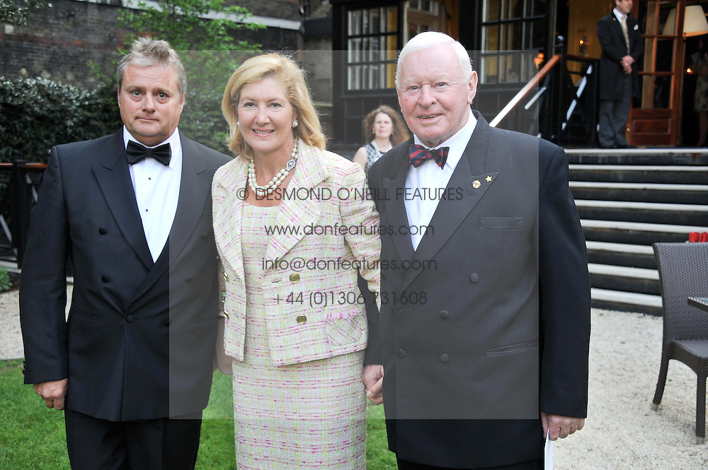 Left to right, CAPT.JULES COPE Captain of the Leander, GABRIELLA di NORA and SIR DONALD GOSLING at a reception hosted by the Friends of the Castle of Mey held at the Goring Hotel, Beeston Place, London on 22nd May 2012.