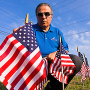 08/29/11 Bear DE: The ultimate sacrifice organizer Dr. Chuck F. Betters install one of 6,194 flags that represents every soldier that died in the war on terror including three soldier that died in Afghanistan on Monday Aug. 29, 2011. <br />