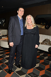 ASHLEY PEARSON and HAKAN EROL at a party to celebrate the publication of Behind The Mask by Emma Sayle held at The Playboy Club, 14 Old Park Lane, London on 23rd April 2014.
