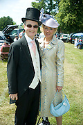 ADAM HELLIKER; MRS ADAM HELLIKER, Royal Ascot. Tuesday. 14 June 2011. <br /> <br />  , -DO NOT ARCHIVE-© Copyright Photograph by Dafydd Jones. 248 Clapham Rd. London SW9 0PZ. Tel 0207 820 0771. www.dafjones.com.