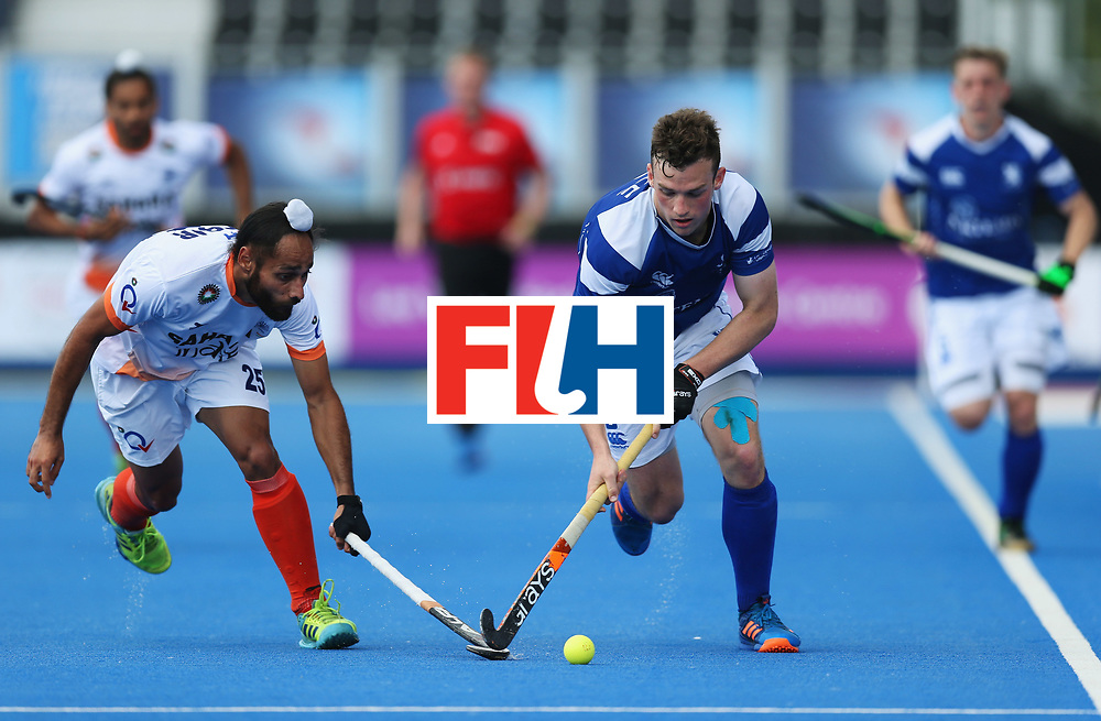 LONDON, ENGLAND - JUNE 15:  Callum Duke of Scotland is chased by Satbir Singh of India during the Pool B match between India and Scotland on day one of Hero Hockey World League Semi-Final at Lee Valley Hockey and Tennis Centreo n June 15, 2017 in London, England.  (Photo by Alex Morton/Getty Images)