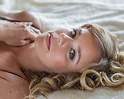 blond woman reclining headshot