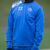 St Johnstone Training....31.01.14<br /> Lee Croft pictured doing neck exercises during training this morning ahead of tomorrow's League Cup Final against Aberdeen.<br /> Picture by Graeme Hart.<br /> Copyright Perthshire Picture Agency<br /> Tel: 01738 623350  Mobile: 07990 594431