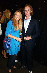 EMILY LOPES and JAMES BYRON at the opening party of the new Frankie's Bar & Grill at Selfridges, Oxford Street, London on 6th September 2006.<br />