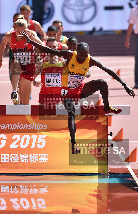 BEIJING, CHINA - AUGUST 22: Benjamin Kiplagat (Uganda) in Round 1 of the mens 3000m steeplechase during day 1 of the 2015 IAAF World Championships at National Stadium on August 22, 2015 in Beijing, China. (Photo by Roger Sedres/Gallo Images)