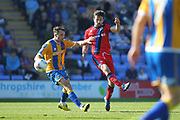 Joe Rafferty clears the ball during the EFL Sky Bet League 1 match between Shrewsbury Town and Rochdale at Greenhous Meadow, Shrewsbury, England on 8 April 2017. Photo by Daniel Youngs.