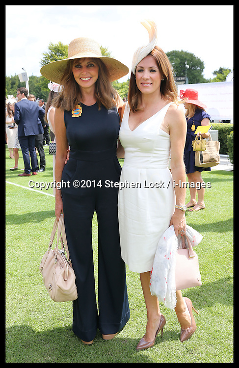 Image licensed to i-Images Picture Agency. 31/07/2014. Goodwood. United Kingdom. Carol Vorderman and Natalie Pinkham  at Ladies Day at Glorious Goodwood.  Picture by Stephen Lock / i-Images