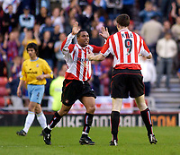 Photo. Jed Wee, Digitalsport<br /> NORWAY ONLY<br /> <br /> Sunderland v Crystal Palace. <br /> Division 1 Playoffs, second leg. 17/05/2004.<br /> Crystal Palace's Danny Butterfield (L) looks on dejecetedly as Sunderland's Jeff Whitley (C) congratulates Kevin Kyle on scoring his side's first goal of the night.